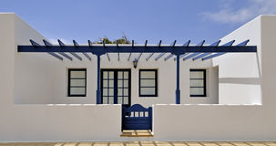 White house with blue porch. White house with blue veranda under the sun Stock Images