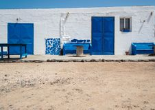 White house with blue windows and doors and sand floor. Fuerteve. Ntura, Canary Islands royalty free stock photography