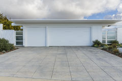 White house with 3 car garage Stock Photo