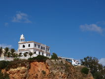 White house on the cliff. In Algarve stock photo