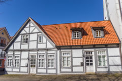 White house on a cobblestoned street in Verden. Germany Stock Images