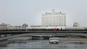 White house ferry traffic under the bridge motion Metro over the bridge across the river in Moscow stock footage
