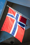 White house with flag in old part of Stavanger, Norway Stock Photo