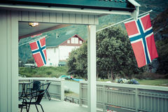 White house with flag in old part of Stavanger, Norway Stock Image