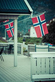 White house with flag in old part of Stavanger, Norway Stock Photos