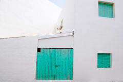 White house with green door in Formentera Stock Images
