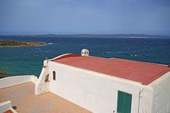 White house on a high cliff in Sant`Antioco island in southern Sardinia stock photo