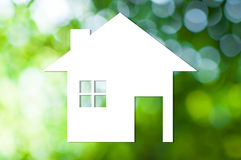 White house icon on nature background as symbol of mortgage. Dream house on nature background stock images