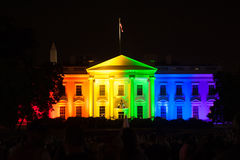 The White House Lit in Rainbow Colors. The White House is lit up in rainbow colors to celebrate the Supreme Court's opinion legalizing gay marriage in all fifty stock photos
