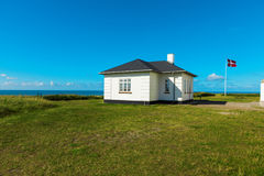 White house in the meadows by the sea Stock Photos