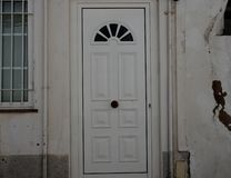 White House With Metal Door And Barred Window In Lagos Portugal stock image