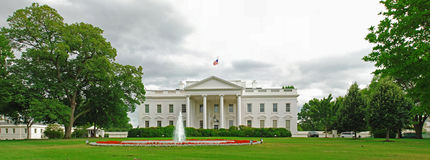 White House North Lawn Panorama. A panorama photo of the White House and its north lawn. Photo taken from the Pennsylvania Avenue Royalty Free Stock Image