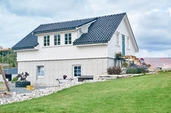 White house on the Norwegian countryside, rural landscape. Fogn, Norway - July 17, 2015: Rural landscape, pasture and farm buildings Rogaland county. Around Stock Photo