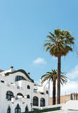 White house with palm trees on coast of Spain Stock Images