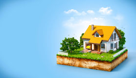 White house. On a piece of earth with garden and trees Stock Photo