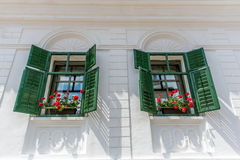 White house with red flowers Royalty Free Stock Photo