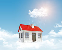White house with red roof, chimney in clouds Royalty Free Stock Photo