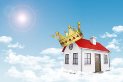 White house with red roof, crown and chimney in Stock Photo