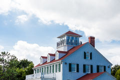 White House Red Roof Green Shutters Stock Photography