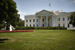 White house sunny day. White house property. Grass and garden in foreground royalty free stock photos
