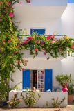 White House with typical blue shutters, Crete stock photo