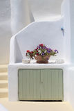 White house and vase with flowers in Santorini, Greece. Royalty Free Stock Photos