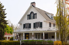 White house with a wraparound porch Royalty Free Stock Image