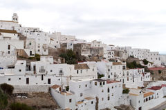 White houses. Architectural complex consisting of white houses next to each other on top of a mountain, is situated in the municipality of Vejer de la Frontera Stock Images