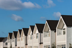 White houses against blue sky Royalty Free Stock Image