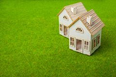 Houses Arranged In Row On Grassy Field Royalty Free Stock Image
