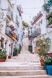 White houses on stairs street on a hill with flower pots royalty free stock photography