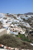 White houses with blue roofs in Santorini Stock Photography