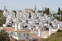 White houses in Carvoeiro Portugal. White houses in Carvoeiro in the Algarve Portugal Royalty Free Stock Image