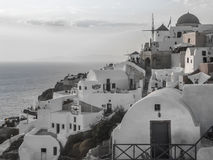 White houses, churches and blue domes in Oia village stock photo