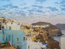 White houses, churches and blue domes in Oia village Royalty Free Stock Photos