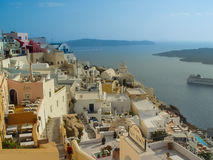 White houses, churches and blue domes in Oia village Royalty Free Stock Photography