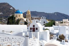 White houses and churches of Oia, Santorini, Greece stock images