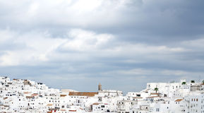 White houses with clouds in the sky. Architectural complex consisting of white houses next to each other on top of a mountain, is situated in the municipality of Royalty Free Stock Images