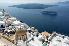 White houses of Fira, Santorini and Nea Kameni volcano in the background Royalty Free Stock Images
