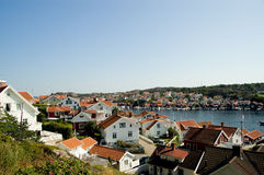 White houses at the fjord. Holiday homes in summer at a fjord in South Sweden. Ideal for people with a boat, they can made great trips on calm water Royalty Free Stock Images