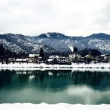 White Houses in Front of Mountains Under White Cloudy Sky Stock Photography