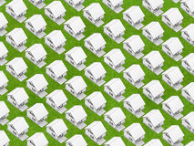White houses on grass. Render of the white houses in orthographic view on the grass texture Royalty Free Stock Photography