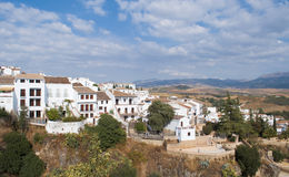 White houses in a landscape. White houses located next to each other in the town of Ronda in Malaga, Spain, are houses perched on a steep mountain Stock Photos