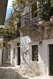Naxos - Apeiranthos houses, paved street with white marble - Cyclades, Greece. White houses in the marble alleys, Apeiranthos traditional village, South Aegean royalty free stock photography