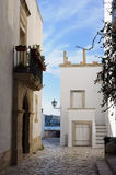 White houses in Otranto. The old city of Otranto with white houses and paved streets. Italy Royalty Free Stock Photography