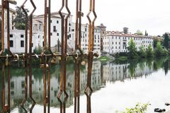 White houses with reflection along river Brenta in Bassano del Grappa, Italy stock photos