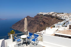White houses of Santorini with Santorini`s famous volcano in the background Stock Photography