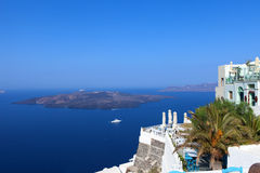 White houses of Santorini with Santorini`s famous volcano in the background Stock Image
