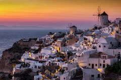 Caldera in the village of Oia, Santorini, Cyclades, Greece. The white houses and windmills at the caldera in the village of Oia, Santorini, Cyclades, Greece royalty free stock photo