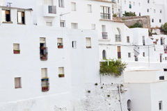White houses with windows. Architectural complex consisting of white houses next to each other on top of a mountain, is situated in the municipality of Vejer de Stock Images